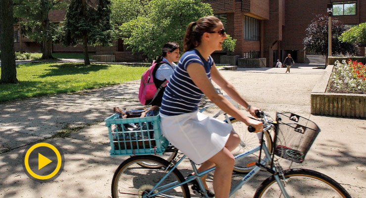 Students riding bicycles on campus