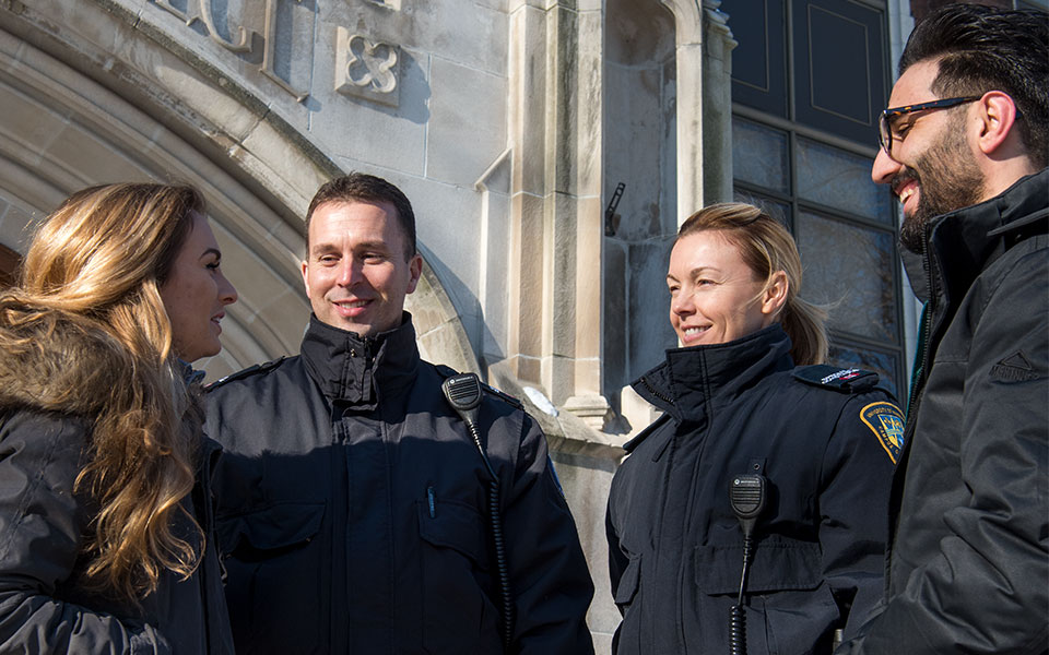 Criminology students meeting two campus police officers