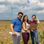 Students in front of a wind turbine